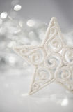 White christmas star on bokeh lights background with space for text. Merry christmas card. Royalty Free Stock Photos