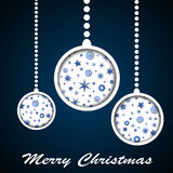 White Christmas toys with stars and snowflakes cuted in paper on dark blue background Stock Image
