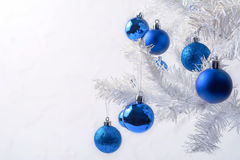 White Christmas tree with blue ornament copy space Stock Images
