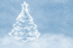 White christmas tree. On a blue snowy background Royalty Free Stock Images