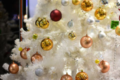 White christmas tree and Christmas decorations. Christmas and new year party concept. Colorful Closeup abstract background. White christmas tree and Christmas Royalty Free Stock Image
