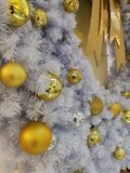 White Christmas tree decoration ornaments and hanging disco and golden ball with silver tinsel background Royalty Free Stock Photo