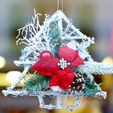 White Christmas tree decoration with red leaves Royalty Free Stock Images
