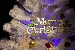 Christmas white tree decoration of Tex `Merry Christmas` for happy new year festival holiday party carnival. White Christmas tree decoration of Tex `Merry Royalty Free Stock Photography