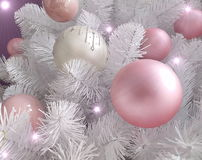 White Christmas tree-detail. White Christmas tree with pink decoration with purple background stock photo
