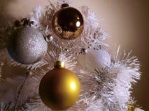 White Christmas tree, gold silver balls silver garland,christmas light,decoration ,illumination ideas royalty free stock image