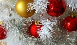 White Christmas tree, gold silver red balls silver garland,christmas light,decoration ,illumination ideas. Christmas tree red and yellow ,white balls garland royalty free stock photography