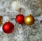 White Christmas tree, gold ,silver, red ,white balls silver garland,christmas light,decoration ,illumination ideas. Christmas tree red and yellow ,white balls stock image
