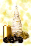White christmas tree with golden candle and cones Royalty Free Stock Images