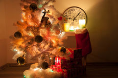 White christmas tree with golden decorations Stock Photo