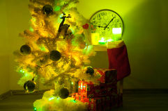 White christmas tree with golden decorations Stock Image