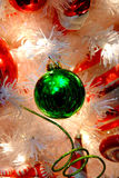White Christmas Tree and Green Decorations Royalty Free Stock Images