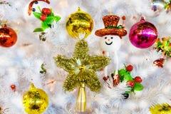 White christmas tree hang toy snowman Stock Image