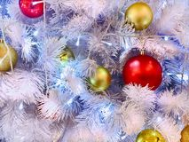 White Christmas Tree with Lighting and Props. Red and Gold Balls Royalty Free Stock Photo