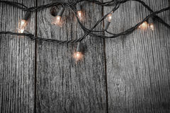 White Christmas Tree Lights with Rustic Wood Royalty Free Stock Photo