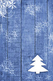 White Christmas tree made from felt on wooden, blue background. Snow flaks image. Christmas tree ornament, craft. Royalty Free Stock Photos