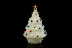 White christmas tree with ornaments. Made with recycled plastic isolated on black Royalty Free Stock Photo