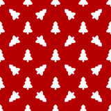 White Christmas tree on red background. Pattern for wrapping paper. White Christmas tree on red background Royalty Free Stock Photos