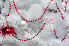 White christmas tree. White and red christmas tree decorated with many presents and on white royalty free stock photo