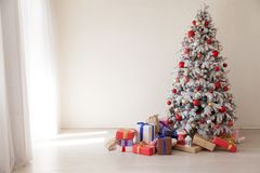 White Christmas tree with red toys new year winter gifts decor. White Christmas tree with red toys new year winter gifts royalty free stock photography