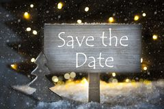 White Christmas Tree, Text Save The Date, Snowflakes. Sign With English Text Save The Date. White Christmas Tree With Snow And Magic Glowing Lights In Backround Royalty Free Stock Image