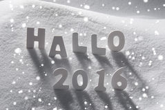 White Christmas Word Hallo 2016 Means Hello On Snow, Snowflakes. White Wooden Letters Building German Text Hallo 2016 Means Hello 2016. Snow And Snowy Scenery royalty free stock photo