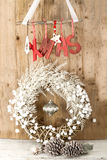 White Christmas wreath on brown wooden vintage background Stock Image