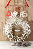 White Christmas wreath on brown wooden vintage background Stock Photo