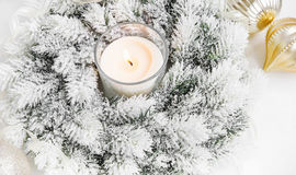 White Christmas Wreath with Burning Candle,Ribbon and Globes Royalty Free Stock Images