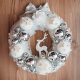 White Christmas wreath with silver decorations on wooden background stock images