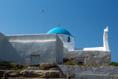 White chuch with blue roof in town of Parakia, Paros island, Greece Stock Images