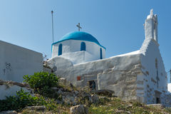 White chuch with blue roof in town of Parakia, Paros island, Greece Royalty Free Stock Images