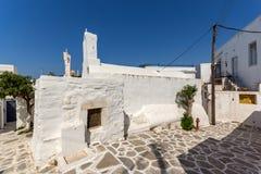 White chuch with blue roof in town of Parakia, Paros island, Greece Royalty Free Stock Photos