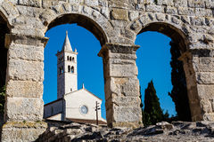 White Church and Ancient Roman Amphitheater Stock Photo