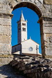 White Church and Ancient Roman Amphitheater. White Church Framed in the Arch of Ancient Roman Amphitheater in Pula, Istria, Croatia Stock Photos