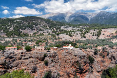 White church and ancient ruins at cliff of Aradena Gorge, Crete island, Greece.  Stock Photography
