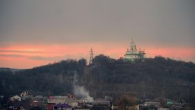 White church on a background of a cloudy sky. sunset sky. religion in eastern europe. poltava, ukraine 4k. White church on a background of a cloudy sky. sunset stock video