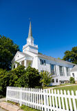 White Church Beyond Picket Fence Royalty Free Stock Photography