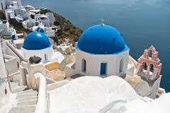 White church with blue dome on a Caldera cliff at Oia village, Santorini island Stock Photo