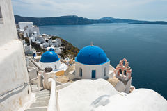 White church with blue dome on a Caldera cliff at Oia village, Santorini island. Greece Stock Image