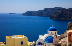 White church with blue dome in Santorini, Greece. Santorini, Greece - White church with blue dome and caldera view Royalty Free Stock Photography