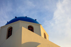 White church with blue dome in Santorini, Greece Royalty Free Stock Images