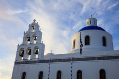 White church with blue dome in Santorini, Greece. Santorini, Greece - White church with blue dome on sky background Royalty Free Stock Images