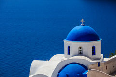 White church with blue dome in Santorini, Greece. Santorini, Greece - White church with blue dome on blue sky background Stock Photos