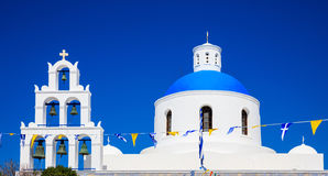 White church with blue dome in Santorini, Greece. Santorini, Greece - White church with blue dome on blue sky background Royalty Free Stock Photography