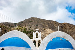 White church with blue domes Kamari beach, Greece Royalty Free Stock Photo