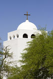 White church with cross. White stucco church steeple with cross on top stock photos