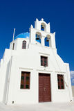 White church, cross, bells Santorini Island Greece Royalty Free Stock Images