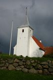 White church, denmark. Danish white church with stone wall, chritianity, religion and weddings royalty free stock photo