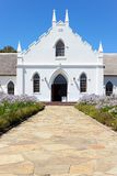 White Church in Franschhoek in front of blue sky royalty free stock photo